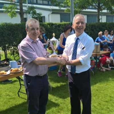 Mr O'Leary presents the Patrician Challenge Cup to Mr Ciaran Doyle.