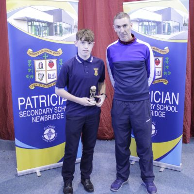 1st Year Basketball winner Padraig Daly with Mr McCool