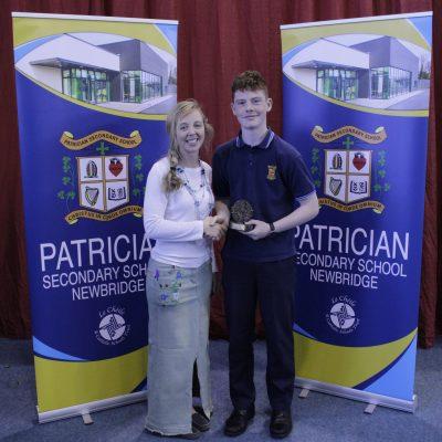 U14 Hurling winner Oran O'Sullivan with Ms Stack