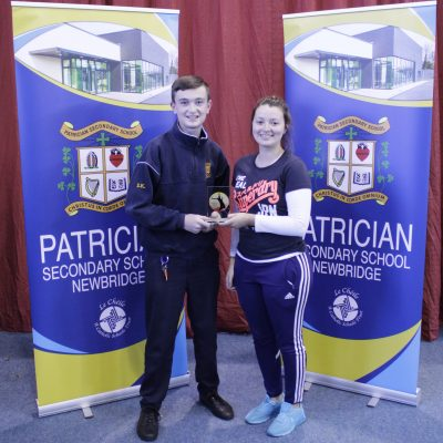 Junior Badminton winner Eoin Kelly with Ms Fitzgerald