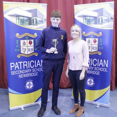 U16 Hurling winner Sam McGuirk with Ms McCarthy