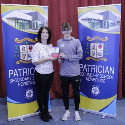 Senior Athletics winner Adam McInerney with Ms Raftery