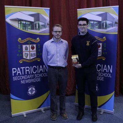 Senior Badminton winner Joey O'Sullivan with Mr Doheny