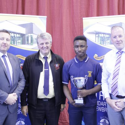 Junior Sportsperson of the Year Nathan Anyanwu with Cian O'Neill, Ian McLoughtlin (EMS Copiers) & Mr Moloney