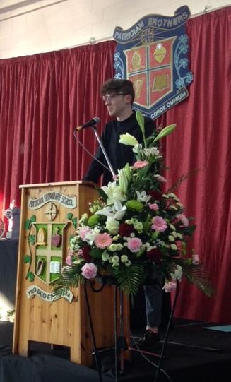 Elliot Nolan addresses the crowd before singing Songbird