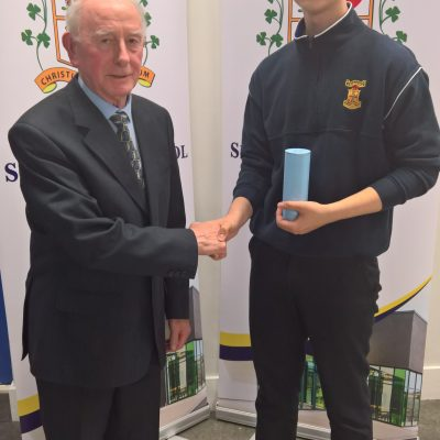 5th Year Matas Misevicius receives his prize for the best JC results from BOM chairman Br Cormac Commins