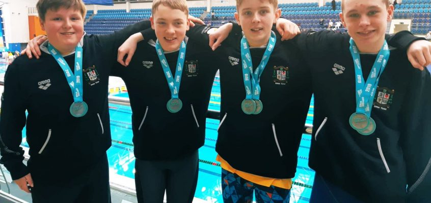 Swim Team Claim Historic National Relay Double